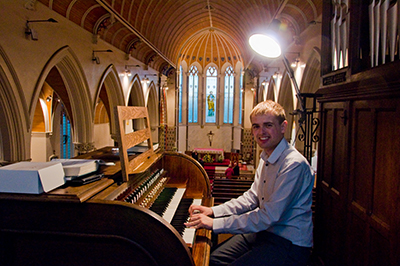 Stephen Terry at the organ after the Songs of Praise evening
