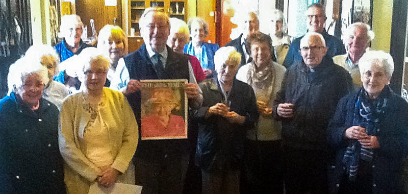 Parishioners raise a glass in the porch to toast the queen