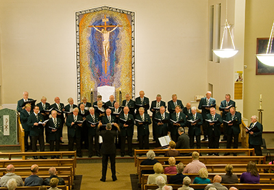 The Apollo Male Voice Choir perform in St. Andrew's Church to celebrate the Golden Jubilee.