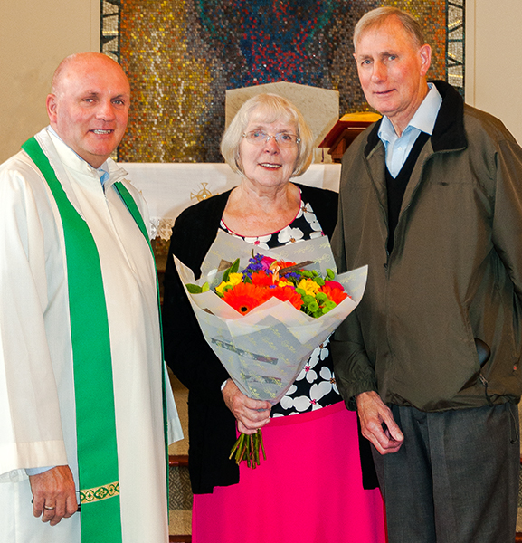 Jim and Eileen Best are presented with a bouquet of flowers to celebrate their Golden Anniversary