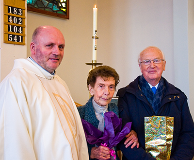 Edna Graham and Peter Conway are presented with their gifts by Parish Priest Fr. Edmond Gubbins.