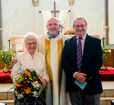 Margaret and Michael Clarke with Fr. Gubbins after renewing their wedding vows