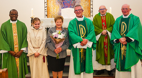 Deacon Pat Thomas with Fr. Damian, altar server Megan Donnegey_Marshall, his wife Dorothy, Fr. Jack and Fr. Michael.