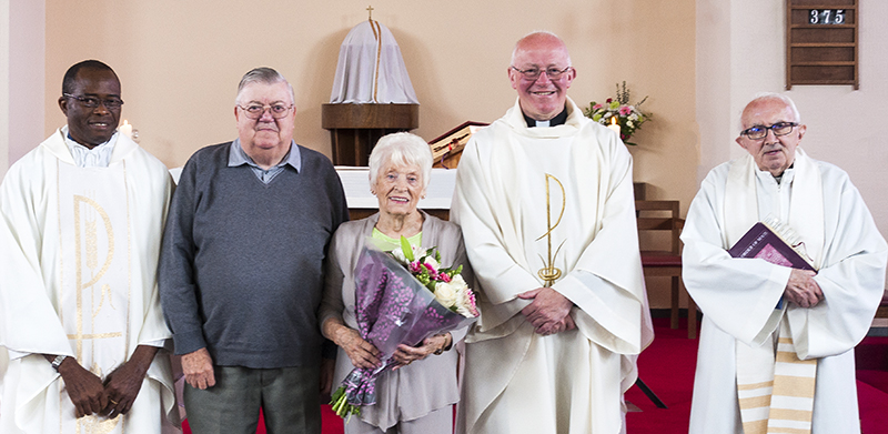Bill and Cath Evans pictured after receiving a bouquet of flowers from Fr. Michael Loughlin, Fr. Damian and Fr. Jack