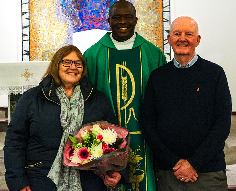 Kath and Joe Gallgher with Fr. Damian