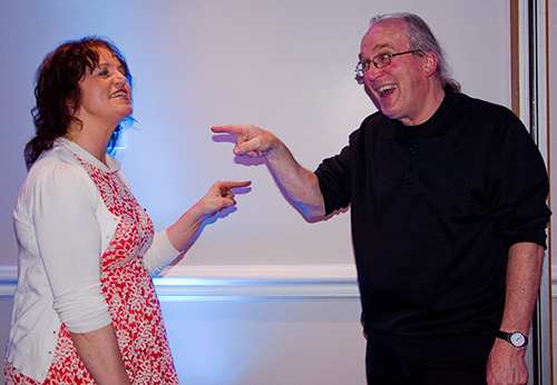 Parishioner Sheila Walsh and Fr. Pat Day disagree over who had the Salmon!