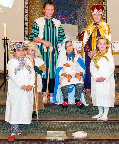 Some children from St. Andrew's Parish formed a tableau during the carol service on Christmas Eve.