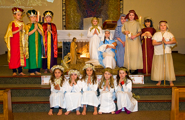 Children from St. Andrew's Parish take part in the Live Bethlehem Nativity scene before Christmas Eve Mass