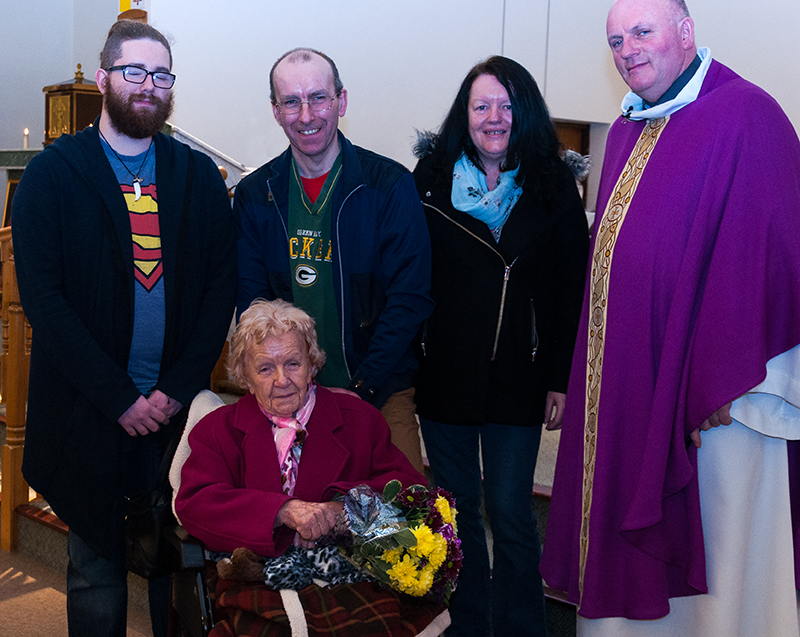 Bernadette Moorfoot is presented with a bouquet of flowers to celebrate her 90th birthday