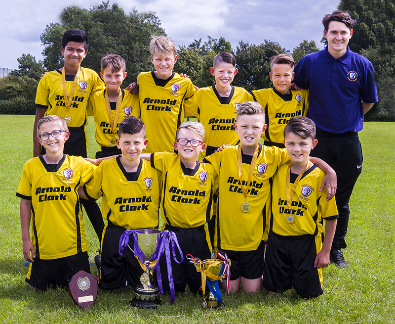 St. Margaret Clitherow's football team with the Catholic Voice Cub and the Heagny Cup