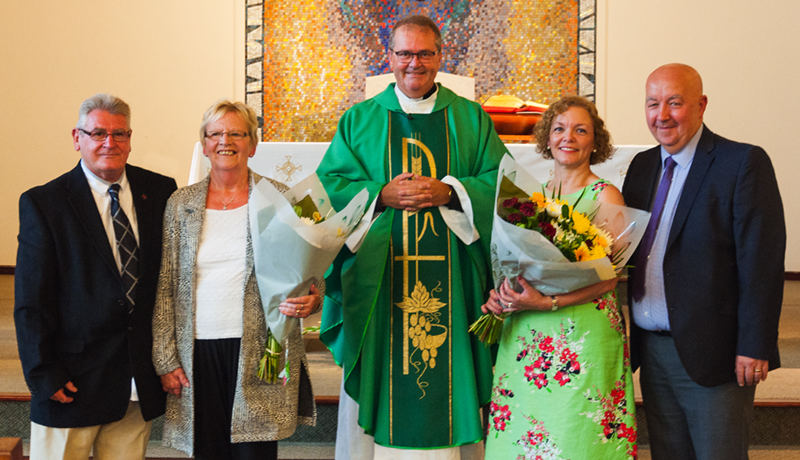 from left, Terry and Barbara Morrow, Canon Alan Sheridan and Marie and John Buckton all celebrated their anniversaries at Saturday evening Mass